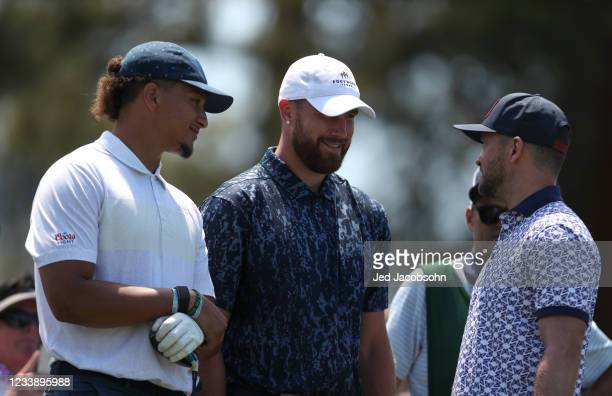 Musician Justin Timberlake, right, and NFL athletes Travis Kelce, center, and Patrick Mahomes talk on the third hole during round one of the American...