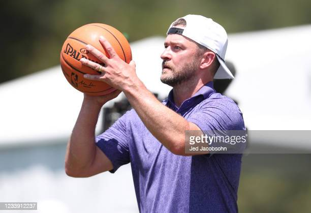 Musician Justin Timberlake shoots a basketball on the 17th hole during round two of the American Century Championship at Edgewood Tahoe South golf...