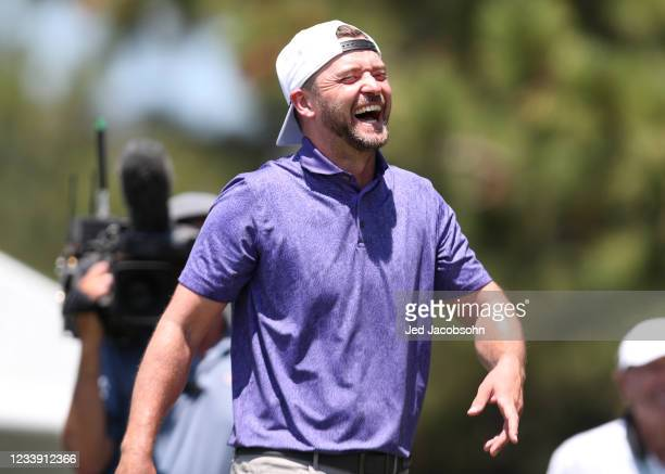 Musician Justin Timberlake smiles on the 17th hole during round two of the American Century Championship at Edgewood Tahoe South golf course on July...