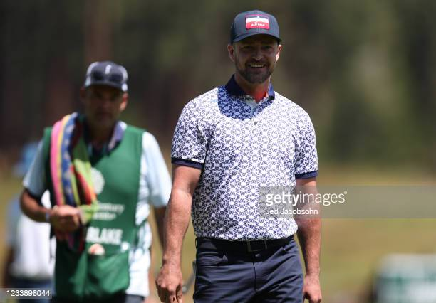 Musician Justin Timberlake smiles on the first hole during round one of the American Century Championship at Edgewood Tahoe South golf course on July...