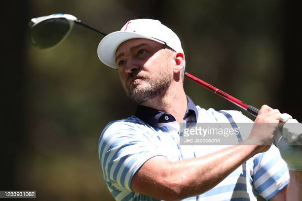 Musician Justin Timberlake tees off on the 16th hole during the final round of the American Century Championship at Edgewood Tahoe South golf course...
