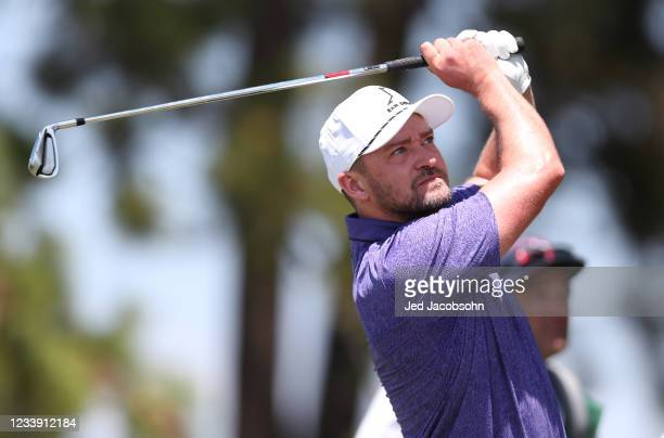 Musician Justin Timberlake tees off on the 17th hole during round two of the American Century Championship at Edgewood Tahoe South golf course on...