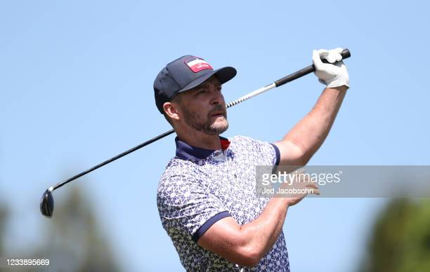 Musician Justin Timberlake tees off on the first hole during round one of the American Century Championship at Edgewood Tahoe South golf course on...