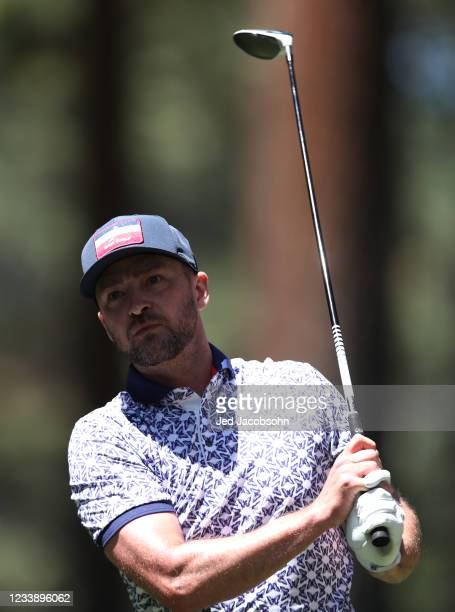 Musician Justin Timberlake tees off on the second hole during round one of the American Century Championship at Edgewood Tahoe South golf course on...