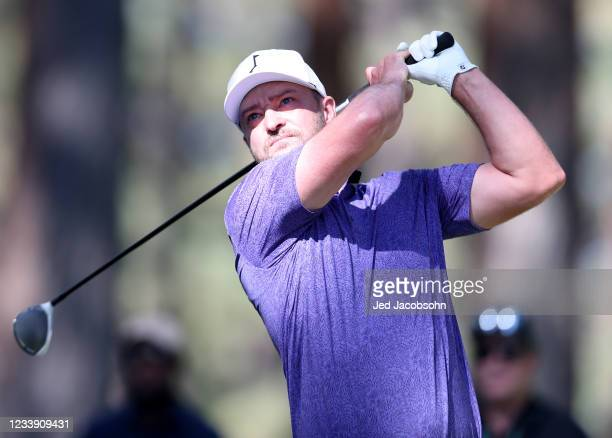 Musician Justin Timberlake tees off on the second hole during round two of the American Century Championship at Edgewood Tahoe South golf course on...