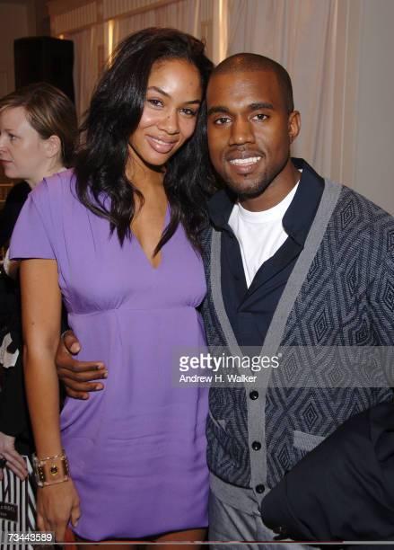 Musician Kanye West and his fiance Alexis Phifer designer of 'Ghita' attend the Henri Bendel presentation of 'The Little Bendel Dress' on February 27...