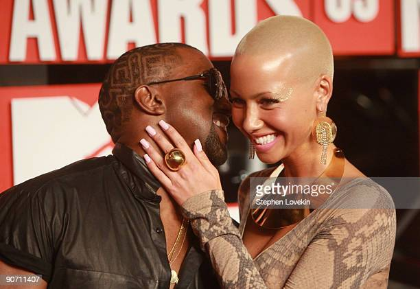 Musician Kanye West and model Amber Rose arrive to the 2009 MTV Video Music Awards at Radio City Music Hall on September 13 2009 in New York City