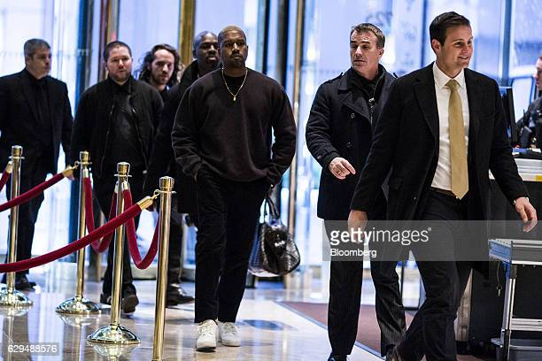 Musician Kanye West arrives in the lobby of Trump Tower in New York US on Tuesday Dec 13 2016 Exxon Mobil Corp Chief Executive Officer Rex Tillerson...