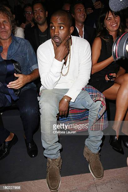Musician Kanye West attends the Diesel Black Gold fashion show during MercedesBenz Fashion Week Spring 2014 at Vanderbilt Hall at Grand Central...