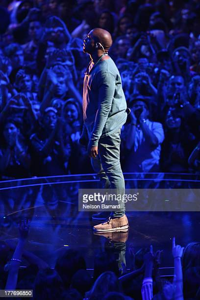 Musician Kanye West performs onstage during the 2013 MTV Video Music Awards at the Barclays Center on August 25 2013 in the Brooklyn borough of New...