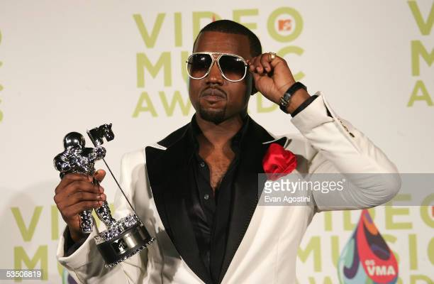 Musician Kanye West poses in the press room with his award for Best Male Video during the 2005 MTV Video Music Awards at the American Airlines Arena...