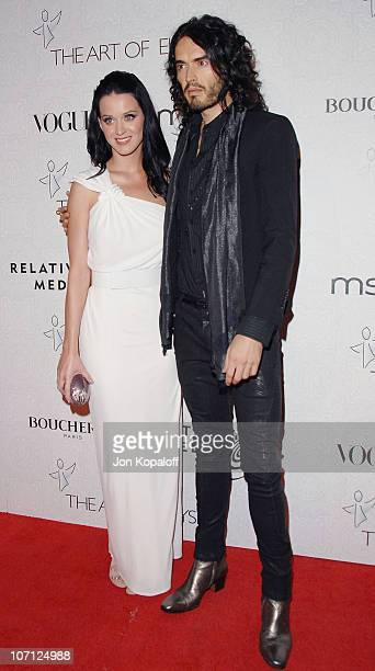 Musician Katy Perry and actor Russell Brand arrive at The Art of Elysium's 3rd Annual BlackTie Charity Gala Heaven at 9900 Wilshire Blvd on January...