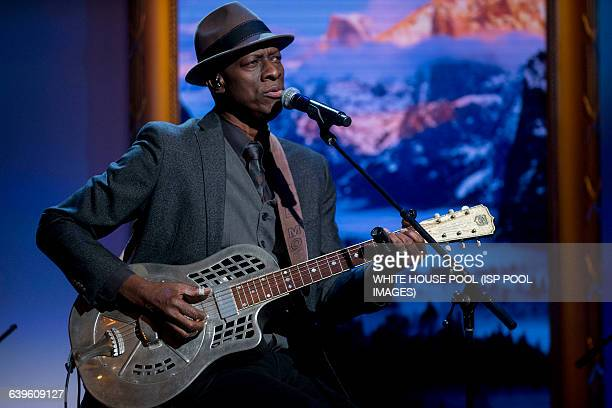 """Musician Keb' Mo' performs during an """"In Performance at the White House"""" event with U.S. President Barack Obama, not pictured, in the East Room of..."""