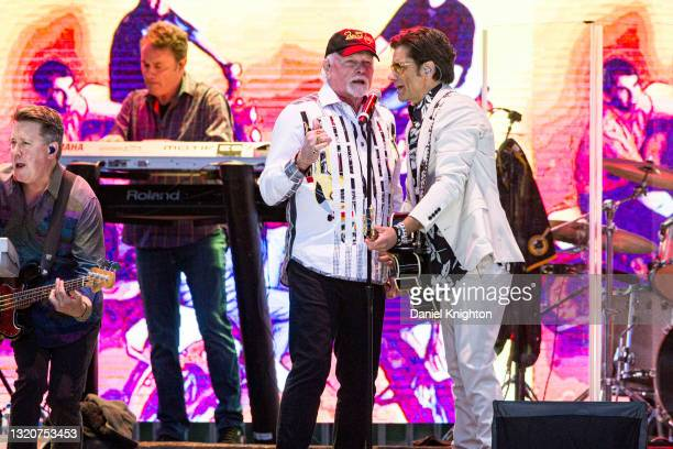 Musician Keith Hubacher, Tim Bonhamme, Mike Love, and John Stamos of The Beach Boys perform on stage at PETCO Park on May 29, 2021 in San Diego,...