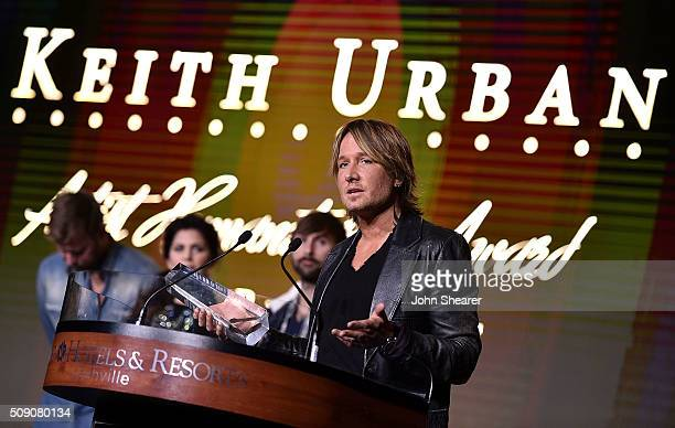 Musician Keith Urban accepts the Artist Humanitarian Award during the CRS 2016 at Omni Hotel on February 8, 2016 in Nashville, Tennessee.