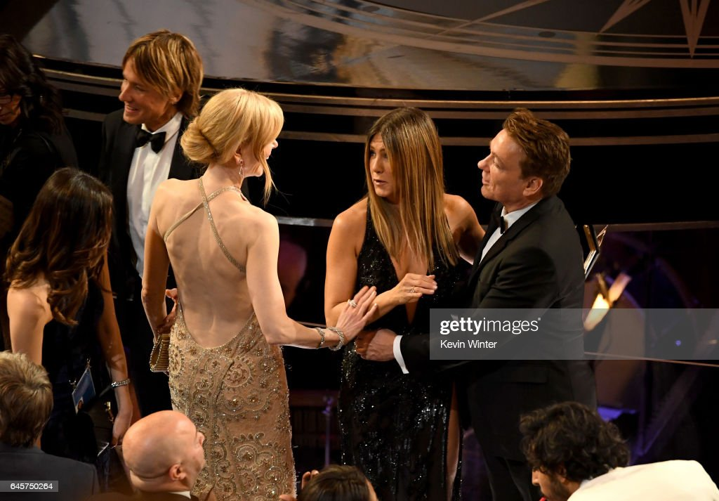 Musician Keith Urban, actors Nicole Kidman and Jennifer Aniston speak in the audience during the 89th Annual Academy Awards at Hollywood & Highland Center on February 26, 2017 in Hollywood, California.