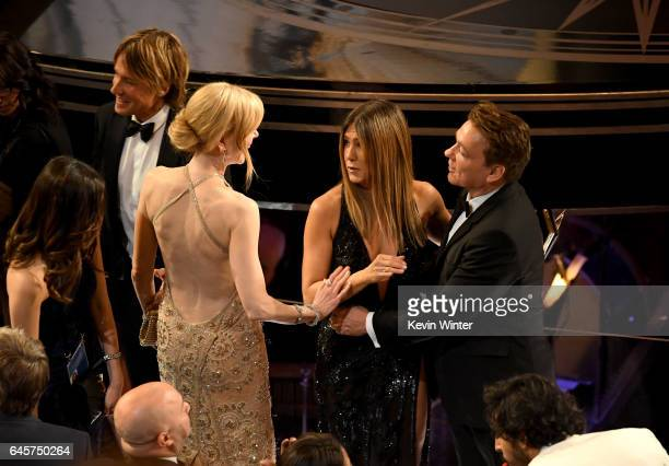 Musician Keith Urban actors Nicole Kidman and Jennifer Aniston speak in the audience during the 89th Annual Academy Awards at Hollywood Highland...