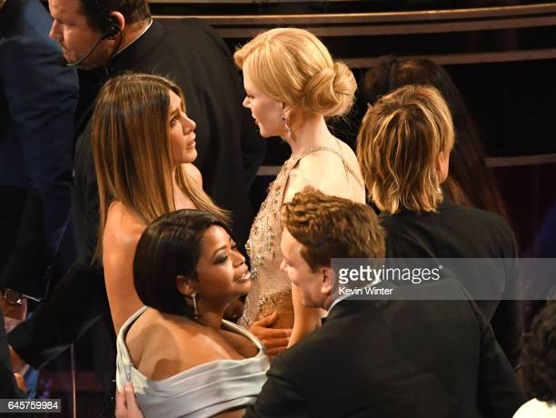 Musician Keith Urban actors Nicole Kidman Jennifer Aniston and Octavia Spencer speak in the audience during the 89th Annual Academy Awards at...