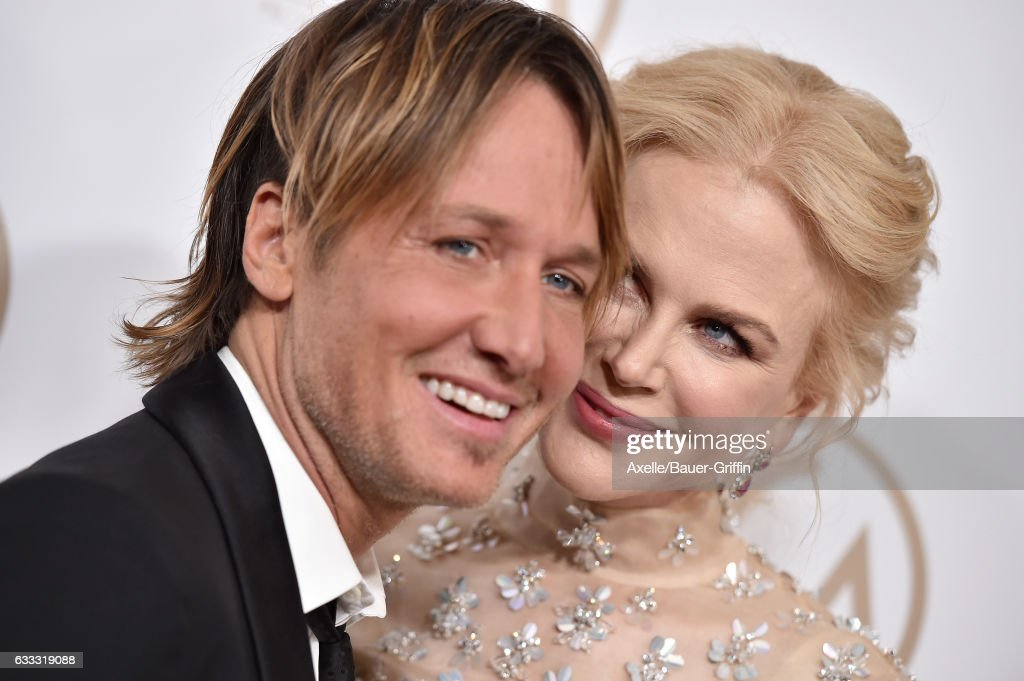 Musician Keith Urban and actress Nicole Kidman arrive at the 28th Annual Producers Guild Awards at The Beverly Hilton Hotel on January 28, 2017 in Beverly Hills, California.