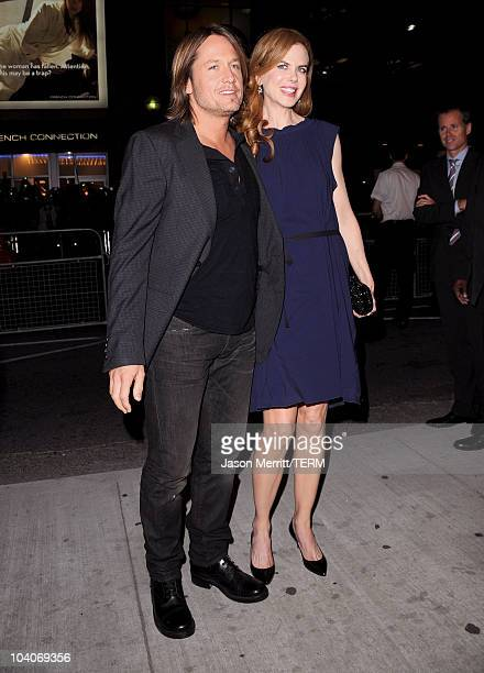 Musician Keith Urban and actress Nicole Kidman arrive at the Rabbit Hole Premiere held at The Elgin during the 35th Toronto International Film...