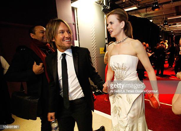 Musician Keith Urban and actress Nicole Kidman walk backstage at the 83rd Annual Academy Awards held at the Kodak Theatre on February 27 2011 in...