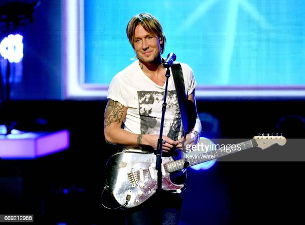 Musician Keith Urban performs onstage during 'Stayin' Alive A GRAMMY Salute To The Music Of The Bee Gees' on February 14 2017 in Los Angeles...