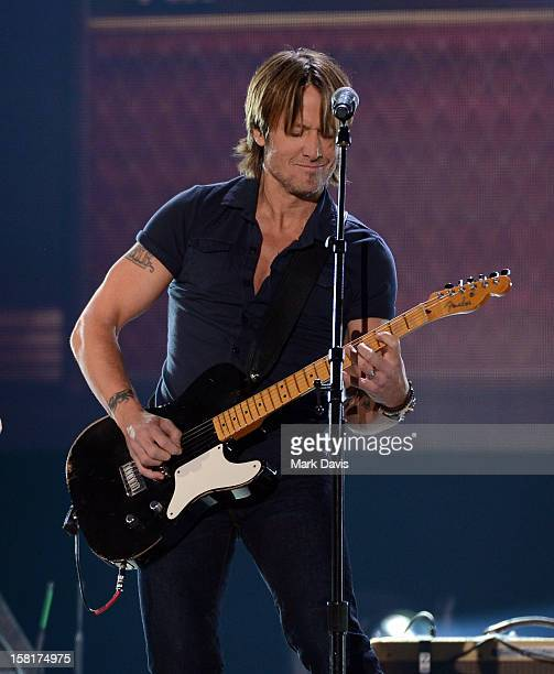 Musician Keith Urban performs onstage during the 2012 American Country Awards at the Mandalay Bay Events Center on December 10 2012 in Las Vegas...