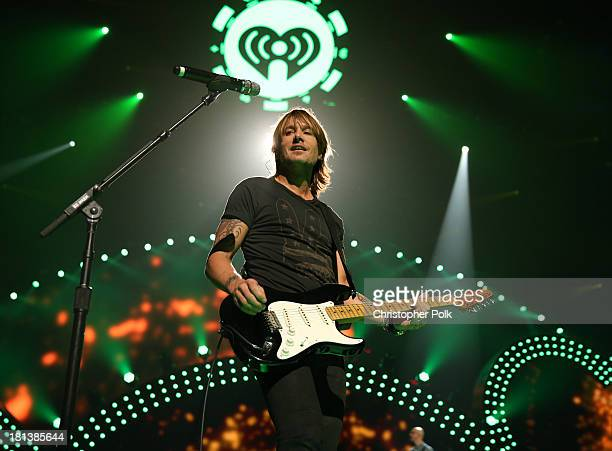 Musician Keith Urban performs onstage during the iHeartRadio Music Festival at the MGM Grand Garden Arena on September 20, 2013 in Las Vegas, Nevada.