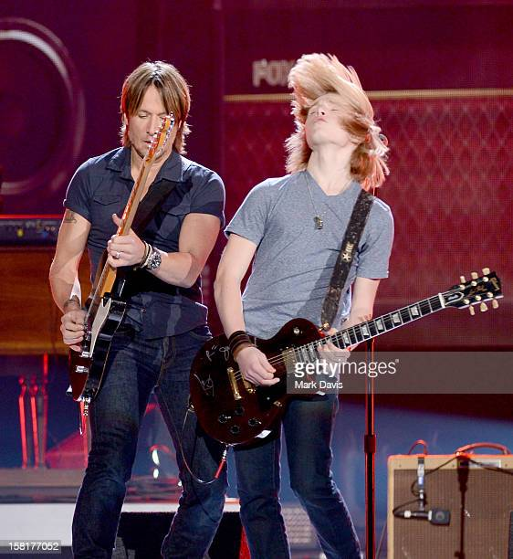 Musician Keith Urban performs with Grammy Foundation's Grammy Camp members onstage during the 2012 American Country Awards at the Mandalay Bay Events...