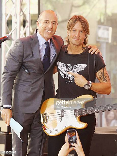 Musician Keith Urban poses with journalist Matt Lauer during his performance on NBC's 'Today' at Rockefeller Plaza on August 7 2015 in New York City