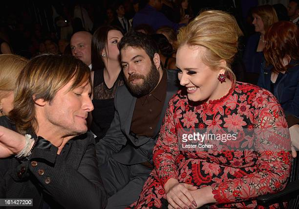 Musician Keith Urban Simon Konecki and Singer Adele attend the 55th Annual GRAMMY Awards at STAPLES Center on February 10 2013 in Los Angeles...