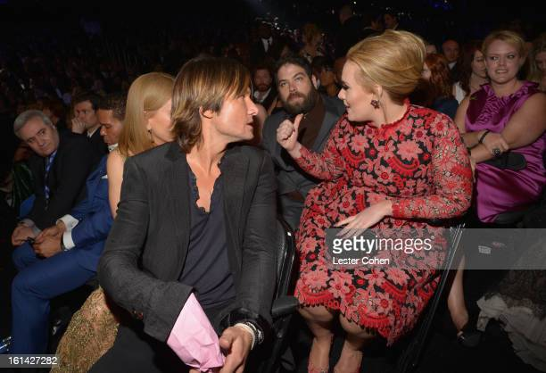 Musician Keith Urban, Simon Konecki, and Singer Adele attend the 55th Annual GRAMMY Awards at STAPLES Center on February 10, 2013 in Los Angeles,...