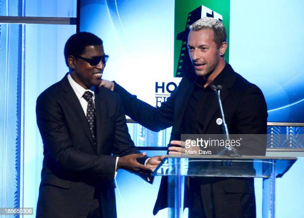 Musician Kenneth 'Babyface' Edmonds and singersongwriter Chris Martin speak onstage during the 17th annual Hollywood Film Awards at The Beverly...