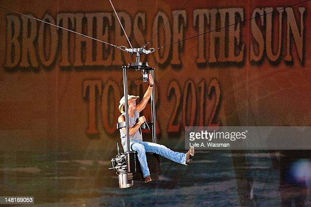 Musician Kenny Chesney performs during the Brothers of The Sun Tour 2012 at Soldier Field on July 7 2012 in Chicago Illinois