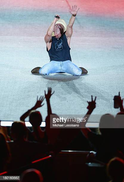 Musician Kenny Chesney performs during the Brothers of the Sun tour at MetLife Stadium on August 11 2012 in East Rutherford New Jersey
