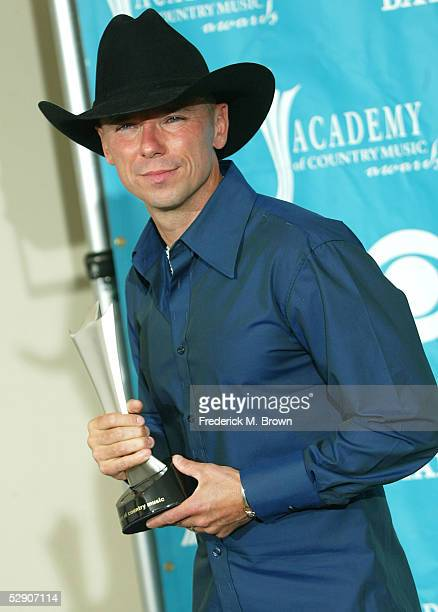 Musician Kenny Chesney, winner of Entertainer of the Year Award poses in the press room at the 40th Annual Academy Country Music Awards at Mandalay...