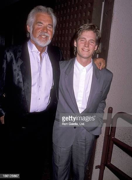 Musician Kenny Rogers and son Kenny Rogers Jr attend the KickOff Celebration of Kenny Rogers Christmas Tour on November 25 1989 at Universal...