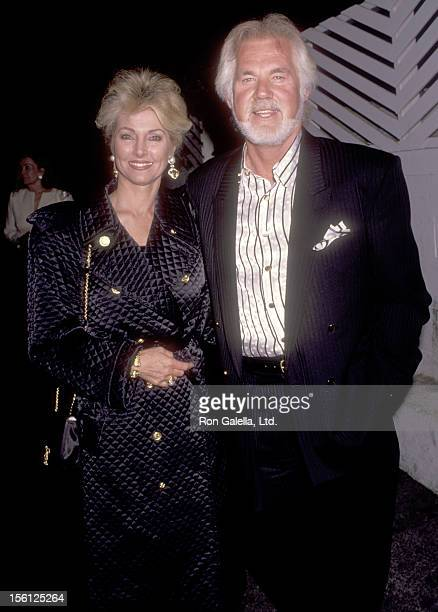 Musician Kenny Rogers and wife Marianne Gordon attend Party for Marvin Davis on June 25 1991 at Spago in West Hollywood California