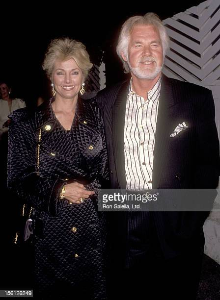 Musician Kenny Rogers and wife Marianne Gordon attend Party for Marvin Davis on June 25, 1991 at Spago in West Hollywood, California.
