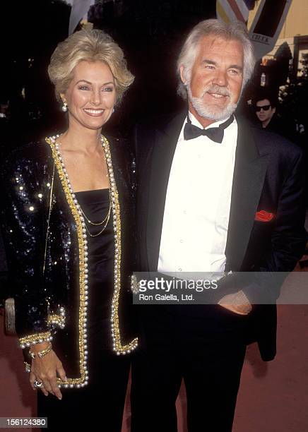 Musician Kenny Rogers and wife Marianne Gordon attend the 'Robin Hood Prince of Thieves' Westwood Premiere on June 10 1991 at Mann Village Theatre in...