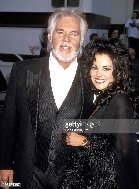 Musician Kenny Rogers and wife Wanda Miller attend the 22nd Annual American Music Awards on January 30 1995 at Shrine Auditorium in Los Angeles...