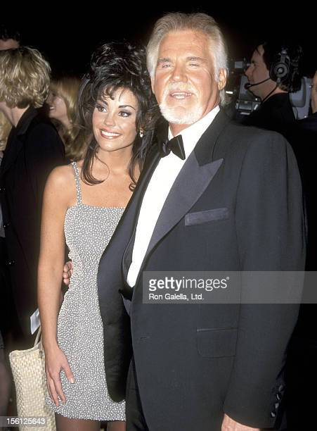 Musician Kenny Rogers and wife Wanda Miller attend the 25th Annual People's Choice Awards on January 10 1999 at Pasadena Civic Auditorium in Pasadena...