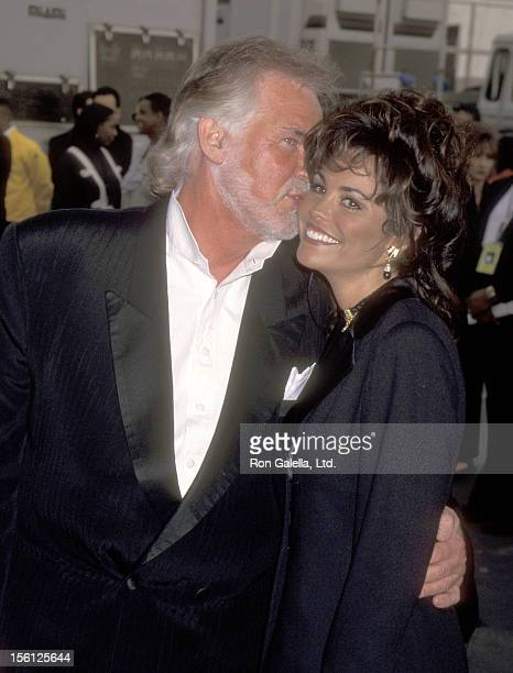 Musician Kenny Rogers and wife Wanda Miller attends the 23rd Annual American Music Awards on January 29 1996 at Shrine Auditorium in Los Angeles...
