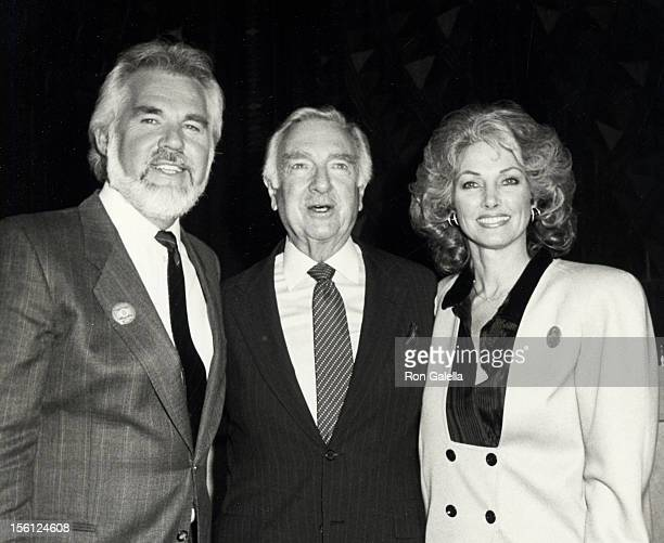 Musician Kenny Rogers, wife Marianne Gordon and Walter Kronkite attending Fourth Annual World Hunger Media Awards on November 26, 1985 at the United...