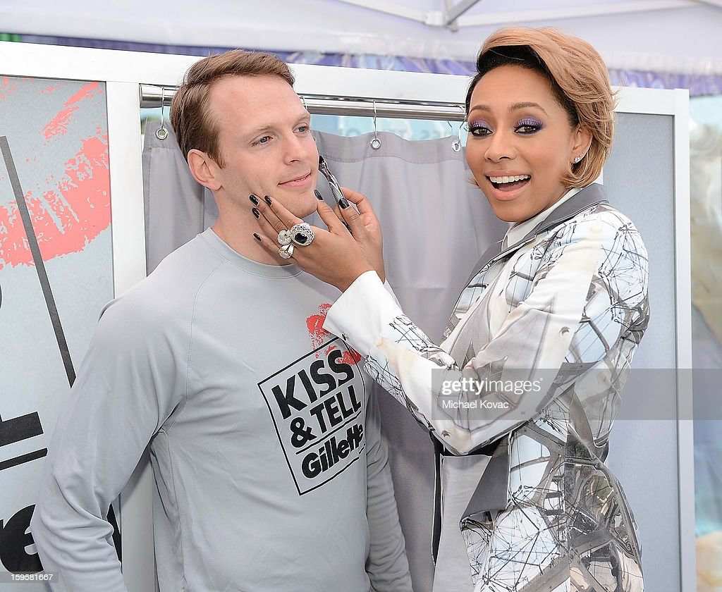 Musician Keri Hilson (R) helps kick off Gillette's 15-city Kiss & Tell Live Experiment at Pacific Park at the Santa Monica Pier by asking women which kiss is best: a kiss with stubble or smooth shaven skin January 16, 2013 in Santa Monica, California.