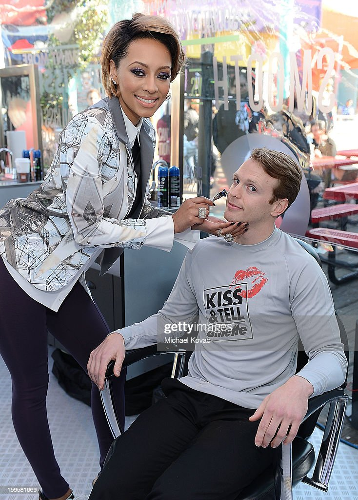 Musician Keri Hilson (L) helps kick off Gillette's 15-city Kiss & Tell Live Experiment at Pacific Park at the Santa Monica Pier by asking women which kiss is best: a kiss with stubble or smooth shaven skin January 16, 2013 in Santa Monica, California.