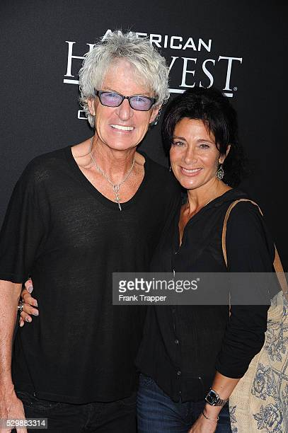 Musician Kevin Cronin and wife Lisa arrive at the premiere of Jobs held at Regal Cinemas LA Live