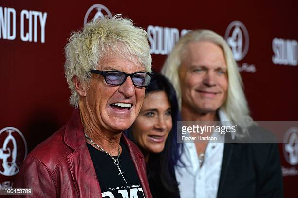 Musician Kevin Cronin Lisa Cronin Bruce Hall arrive at the Premiere Of Sound City at ArcLight Cinemas Cinerama Dome on January 31 2013 in Hollywood...