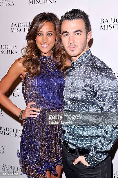Musician Kevin Jonas and Danielle Deleasa pose backstage at the Badgley Mischka show during the Spring 2013 MercedesBenz Fashion Week at The Theatre...