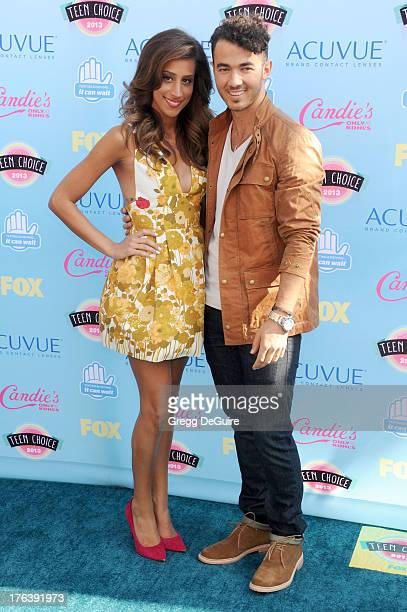 Musician Kevin Jonas and wife Danielle Deleasa arrive at the 2013 Teen Choice Awards at Gibson Amphitheatre on August 11 2013 in Universal City...